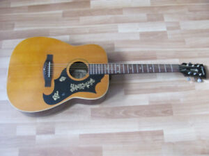 NICE VINTAGE SIX STRING GUITAR FROM THE SEVENTIES.