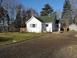 Nice bungalow on an acre just outside of Amherst!
