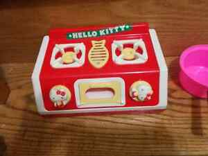 Hello kitty stove and play dishes