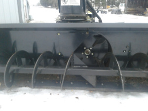 Bob cat skid steer snowplower