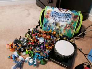 Nintendo wii and -> Skylander giants with launch pad and 30 char