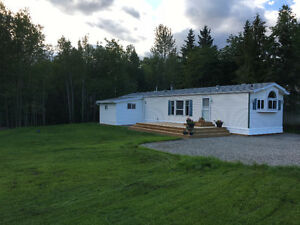 Location! Dragon Lake 14x70' on .29ac
