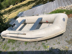 Excellent condition inflatable boat with motor