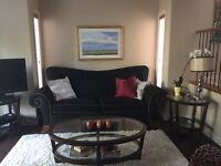 Beautiful couch, chairs, end tables, lamps and rug!  Full set
