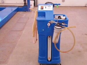 2 WYNN'S MACHINES- TRANSMISSION FLUSH AND COOLANT FLUSH AND FILL