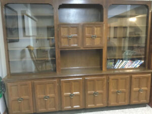 Used as China cabinet and muscle car collection