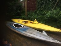 2 x fibreglass canoes with paddles