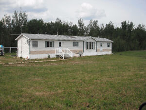 7.78 Acres with well kept home priced to sell