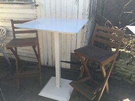 Pair of bistro white metal table and 2 wooden hair chair