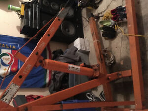 Engine hoist and Chevy 350 with stand for sale.