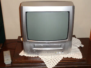 RCA TV/VHS COMBINATION & APPROX 100 VHS MOVIES & SONY PLAYER
