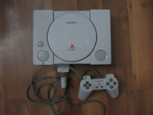 Playstation 1 with one controller and 2 games