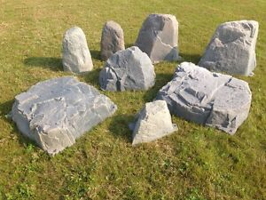 Fake rocks to cover landscaping obstacles