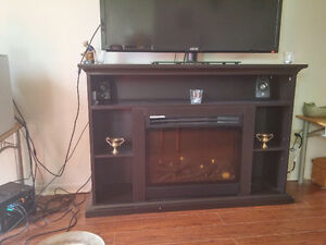 Fireplace entertainment center with remote.