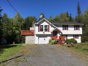 Great split entry on 1.49 acres of land between F'ton & Oromocto