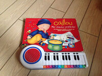 Caillou piano book with 12 songs to sing & play notes