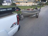 14' aluminum fishing boat with 25 hp merc+ trailer