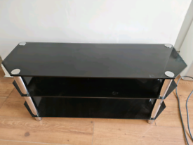 Free black glass TV stand holds upto 50inch tv