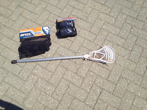 Boys lacrosse stick with pads - $ 35.00