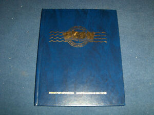 THE STAMP TRAVELLERS-CANADA POST STAMP ALBUM-FULL OF STAMPS