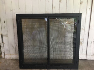Fireplace face plate, solid steel with solid mesh doors