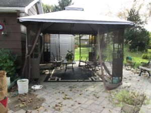 Gazebo  10' x 12'  Glass  in corners and shelves.  What a buy