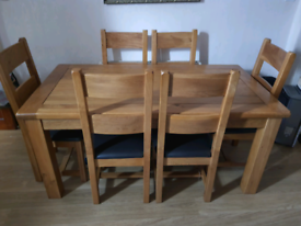 Solid oak wooden dining table with 6 chairs