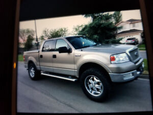*04 FORD LARIAT LIFTED 4X4*