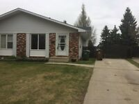 Half Duplex in St. Albert with huge fenced yard! Must sell