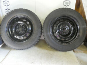 Two snow tires and rims for Acura Integra