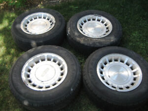 16 inch MAG WHEELS  WITH 225 70R 16 TIRES  LOTS OF TREAD LEFT