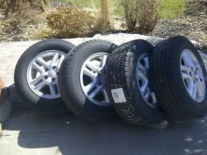 "Toyota OEM Alloy 16""  rims in great shape with tires mounted"