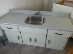 kitchen cupboard with tap and sink