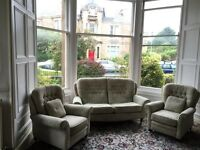 Classic traditional large sofa and three matching armchairs