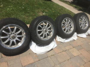 4 winter tires and rims - lightly used - $500 or best offer