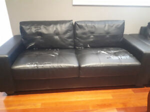 Faux leather sofa and chair