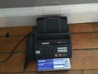 Fax Machine and phone. Spare new roll of ribbon