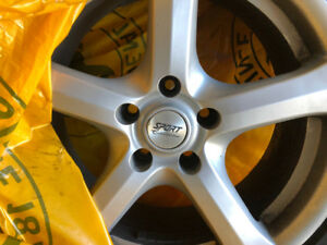 Four great rims and used tires