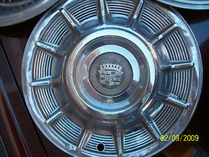CADILLAC RIMS 1959-60,SKIRTS,DASHES,BUMPER ENDS,HUBCAPS,CARS. London Ontario image 1