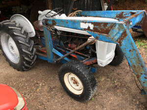 Ford jubilee with loader has trip bucket  or trade for livestock