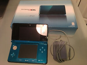 Blue Nintendo 3DS with box and charger