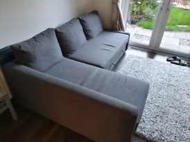 Corner sofa with pull out bed.