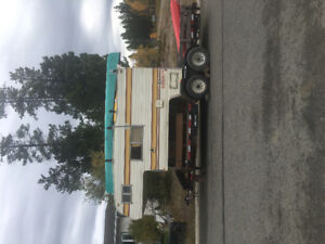 Camper and trailer with ramps