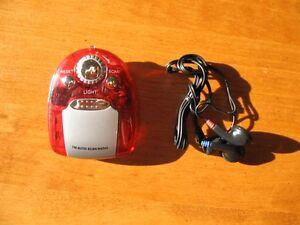 Radio FM portative avec écouteurs (neuve)