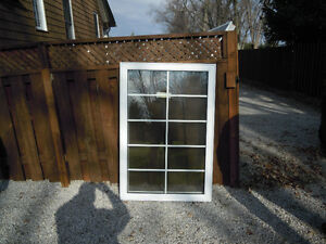 Window, NEW, casement, opens left,37x55, white with grills