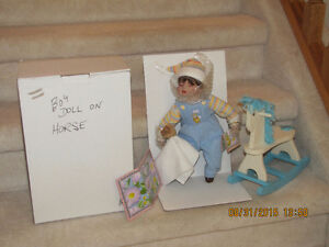 Porcelain Boy Doll on Rocking Horse