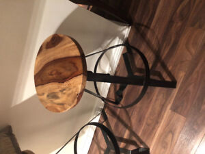 2 wooden and iron bar stools