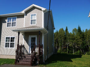 SEMI DETACHED IN DIEPPE WITH TREE LINED BACKYARD!