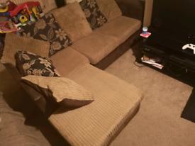Corner sofa and puffer