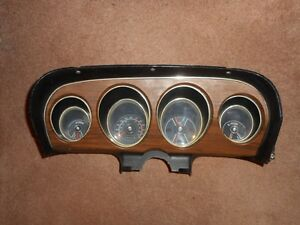 1969 Mustang woodgrain dash cluster - complete - nice condition